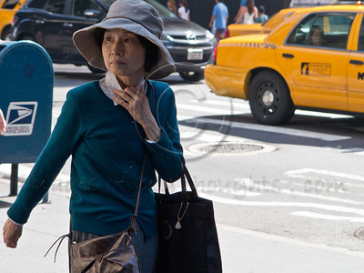 A woman with asian appearance on a Manhattan street. New York, New York, USA. 24-July-2012. New York, the most populous city in the US, the cultural and financial capitals of the world, is overwhelming. Diversity is tremendous and the rhythm and power of the city vertiginous. They say you either love it or hate it - I am still undecided.