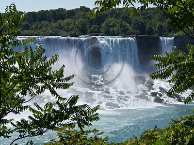 Horseshoe Falls, on the Canadian side of Niagara Falls, is the largest of the three falls. The international boundary line originally drawn through Horseshoe Falls in 1819 has long been in dispute due to natural erosion and construction. Niagara Falls, Ontario, Canada. 29-July-2012.  Niagara Falls are comprised of three waterfalls between Ontario Canada and New York State on the Niagara River draining Lake Erie into Lake Ontario. Falls form highest flow rate of any waterfall in the world with a drop of more than 50 meters.