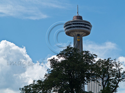 The Skylon Tower is an observation tower that overlooks Niagara Falls from the Canadian side of the Niagara River. It was opened on October 6, 1965 by New York Governor Nelson Rockefeller and Ontario Premier John Robarts. Niagara Falls, Ontario, Canada. 29-July-2012.  Niagara Falls are comprised of three waterfalls between Ontario Canada and New York State on the Niagara River draining Lake Erie into Lake Ontario. Falls form highest flow rate of any waterfall in the world with a drop of more than 50 meters.