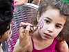 A young girl gets her face painted as Street Art Festival opens hosted by the Jerusalem Center for Performing Arts. Jerusalem, Israel. 14-August-2012.<br /> <br /> Street Art Festival opens hosted by the Jerusalem Center for Performing Arts inviting the public to watch the artists in action and to take part and experience art. The festival will run for three days. Admission is free.
