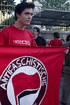 A young man holds up a red anti fascism flag outside the PM?s residence at an anti Iranian-strike protest. Jerusalem, Israel. 23-August-2012.  Some fifty demonstrators outside the Prime Mi ...
