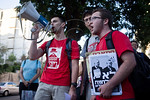 Megaphone bearing young man leads protesters in shouting out slogans against a military strike on Iran and against government outside the PM?s residence. Jerusalem, Israel. 23-August-2012. ...