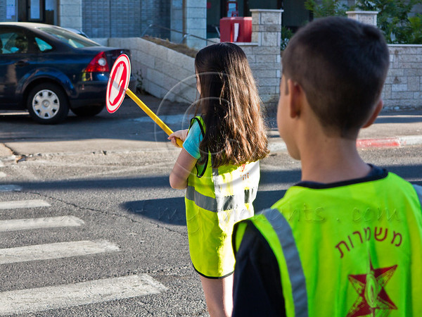 Sixth grade students perform the services of traffic monitoring and assisting younger students in safe access to Yeffe-Nof Elementary School. Jerusalem, Israel. 27-Aug-2012.<br />  <br /> Israeli children go back to school today, abolishing traditional Sept. 1st date, in a first stage of reforms initiated by Ministry of Education aiming to shorten summer vacation to 6 weeks, partially relieving parents of enormous financial expenses.