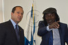Jerusalem Mayor Nir Barkat and reggae musician Alpha Blondy exchange small-talk and numerous smiles in the mayor's office. Jerusalem, Israel. 28-Aug-2012.<br /> <br /> Jerusalem Mayor Nir Barkat welcomes Alpha Blondy to Jerusalem in his office at City Hall, on the occasion of Blondy's fourth visit to Israel. Alpha Blondy will perform tonight at the Jerusalem Reggae Festival in Sacher Park.