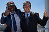 """Jerusalem Mayor Nir Barkat and reggae musician Alpha Blondy pose for photos after Barkat presents Blondy with a military style cap that reads """"Jerusalem, here I am"""" on a balcony outside mayor's office. Jerusalem, Israel. 28-Aug-2012.<br /> <br /> Jerusalem Mayor Nir Barkat welcomes Alpha Blondy to Jerusalem in his office at City Hall, on the occasion of Blondy's fourth visit to Israel. Alpha Blondy will perform tonight at the Jerusalem Reggae Festival in Sacher Park."""