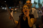 A young woman shouts out slogans against a military strike on Iran and against the government at Paris Square. Jerusalem, Israel. 30-August-2012.  Less than two dozen protest at Paris Square ...