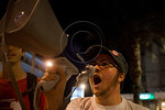Megaphone bearing young man leads protesters in shouting out slogans against a military strike on Iran and against the government at Paris Square. Jerusalem, Israel. 30-August-2012.  Less th ...