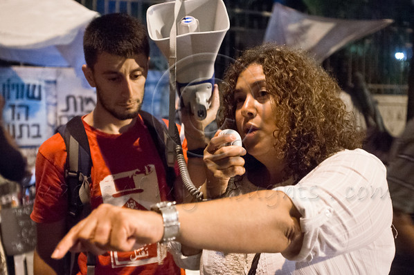 "Egyptian-born, British, Palestinian, Manal Timraz, 42, joins Israeli peace advocators. ""Do not be disheartened by your numbers"" she encourages, ""shout out loud until two million march in Jerusalem"". Jerusalem, Israel. 30-August-2012.<br /> <br /> Less than two dozen protest at Paris Square and march to the Prime Minister's residence calling on PM Benjamin Netanyahu and Defense Minister Ehud Barak to drop intentions of a military strike on Iranian nuclear facilities. Jerusalem, Israel. 30-August-2012."