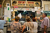 Customers line up to purchase fresh fish from well-known, David Fish, at the Mahane Yehuda Market, in preparation for Rosh Hashana, the Jewish New Year. Jerusalem, Israel. 4-September-2012.<br /> <br /> Agriculture Ministry estimates more than 1,000 tons of carp will be transformed into Gefilte Fish, a traditional Jewish European dish, patties of deboned, ground, carp, whitefish or pike, and consumed during the upcoming Jewish High Holidays.