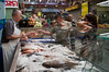 Customers purchase fresh fish at the Mahane Yehuda Market in preparation for Rosh Hashana, the Jewish New Year. Jerusalem, Israel. 4-September-2012.<br /> <br /> Agriculture Ministry estimates more than 1,000 tons of carp will be transformed into Gefilte Fish, a traditional Jewish European dish, patties of deboned, ground, carp, whitefish or pike, and consumed during the upcoming Jewish High Holidays.