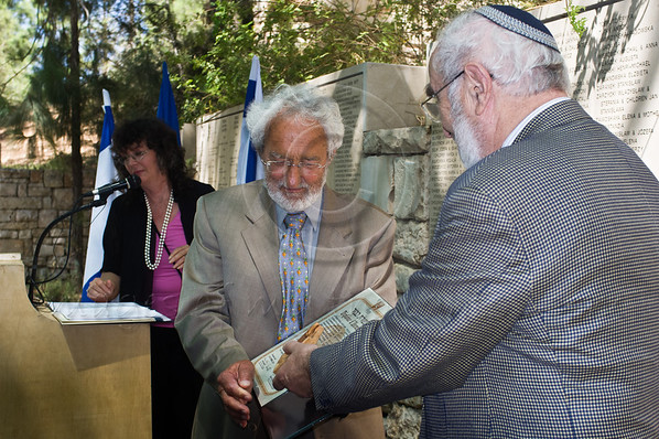 Grandson Olivier de Menthon receives certificate and medal on behalf of grandfather, Count Henry de Menthon, as Righteous Among the Nations, from holocaust survivor Jacky Ofen on behalf of the Commission for the Designation of the Righteous. Jerusalem, Israel. 5-September-2012.<br /> <br /> Yad Vashem holds a ceremony posthumously honoring Count Henry de Menthon as Righteous Among the Nations. The event takes place in the presence of the survivor Dina Godschalk and French Ambassador to Israel HE Christoph Bigot, family and friends.