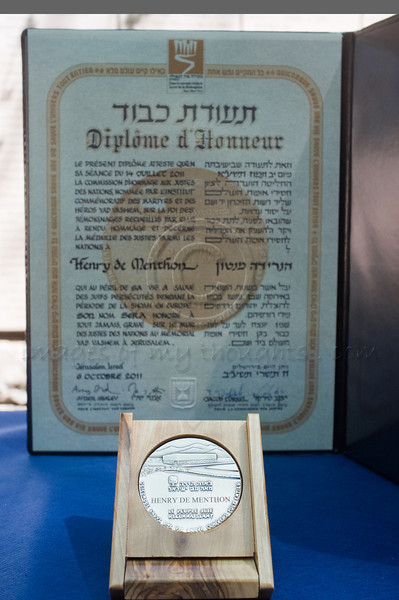 Certificate and medal, honoring Count Henry de Menthon as Righteous Among the Nations, presented to grandson, Olivier de Menthon, at a ceremony at Yad Vashem Holocaust Museum. Jerusalem, Israel. 5-September-2012.<br /> <br /> Yad Vashem holds a ceremony posthumously honoring Count Henry de Menthon as Righteous Among the Nations. The event takes place in the presence of the survivor Dina Godschalk and French Ambassador to Israel HE Christoph Bigot, family and friends.