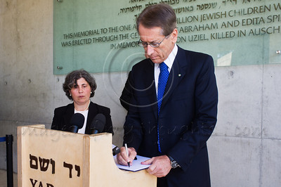 Coming out of the Children's Memorial Hall, Italian Foreign Minister Gulio Terzi, signs the guest book at Yad Vashem Holocaust Museum. Jerusalem, Israel. 5-September-2012.  Italian FM Gulio Terzi visits Yad Vashem Holocaust Museum. The Foreign Minister toured the museum, participated in a memorial ceremony and signed the museum guest book.