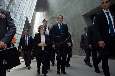 Italian Foreign Minister Gulio Terzi's entourage walks towards exit of main Yad Vashem Holocaust Museum building. The structure is 180 meters long in the form of a spike cutting through the mountain with a skylight. Jerusalem, Israel. 5-September-2012.  Italian FM Gulio Terzi visits Yad Vashem Holocaust Museum. The Foreign Minister toured the museum, participated in a memorial ceremony and signed the museum guest book.