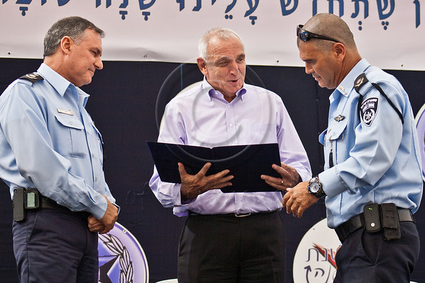 Minister of Internal Security Yitzhak Aharonovitch (C) and Police Commissioner Yohanan Danino (L)  present Commander Yossi Pariente (R) with a letter of appointment as Jerusalem District Police Chief at a ceremony on the Eve of the Jewish New Year. Jerusalem, Israel. 10-September-2012. <br /> <br /> Commander Yossi Pariente is formally appointed Jerusalem District Police Chief at Israel Police National HQ, replacing Niso Shacham, suspended due to investigation for alleged sexual misconduct involving female officers under his command.