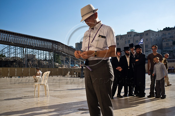"A Hibakusha, a Hiroshima child survivor, prepares what is perhaps the first origami crane prayer to be laid in the crevices between the Western wall stones in its 2,000 year history. Jerusalem, Israel. 10-September-2012.<br /> <br /> Hibakusha, survivors of the August 6th, 1945 bombing of Hiroshima, visit Israel to promote nuclear abolition. Calling ""No More Hiroshimas, No More Nagasakis!"" they place their prayers between the Kotel stones."