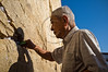 "Miyake Nobuo, 83, survivor of Hiroshima at age 16, 2Km from the hypocenter, places a prayer for nuclear abolition in the crevices between the stones of the western Wall. Jerusalem, Israel. 10-September-2012. <br /> <br /> Hibakusha, survivors of the August 6th, 1945 bombing of Hiroshima, visit Israel to promote nuclear abolition. Calling ""No More Hiroshimas, No More Nagasakis!"" they place their prayers between the Kotel stones."