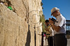 """A Hibakusha, a Hiroshima child survivor, prays at the Western Wall besides a religious Jew. Jerusalem, Israel. 10-September-2012.<br /> <br /> Hibakusha, survivors of the August 6th, 1945 bombing of Hiroshima, visit Israel to promote nuclear abolition. Calling """"No More Hiroshimas, No More Nagasakis!"""" they place their prayers between the Kotel stones."""