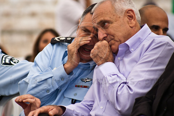 Minister of Internal Security Yitzhak Aharonovitch (R) and Police Commissioner Yohanan Danino (L) exchange whispered secrets while attending a ceremony at Israel Police National Headquarters. Jerusalem, Israel. 10-September-2012.<br /> <br /> Minister of Internal Security Yitzhak Aharonovitch, Police Commissioner Yohanan Danino, Chief Rabbi Yona Metzger, officers, families and friends, assemble on the Eve of the Jewish New Year, Rosh Hashanah, to celebrate promotions and the New Year.