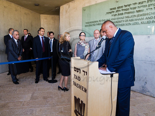 Prime Minister of Bulgaria, Boyko Borissov, signs the Yad Vashem guest book following a visit in the museum. Jerusalem, Israel. 11-September-2012.<br /> <br /> Prime Minister of Bulgaria, Boyko Borissov, leads a delegation of 12 government ministers to Israel for meetings with Israeli counterparts and signing of several agreements. Delegation visits Yad Vashem Holocaust Museum.