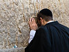 A man buries his head in the stones of the Western Wall as he prays on the Eve of the Jewish New Year, Rosh Hashanah. Jerusalem, Israel. 16-September-2012.<br /> <br /> Thousands pray at the Western Wall on the Eve of the Jewish New Year for the last time in the year 5772. According to the Jewish calendar the year 5773 and the Jewish High Holidays will begin tonight after sunset.