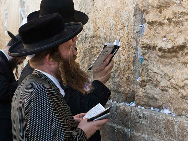 Ultra-Orthodox religious men with traditional long sidelocks pray at the Western Wall, the Kotel, on the Eve of the Jewish New Year, Rosh Hashanah. Jerusalem, Israel. 16-September-2012.<br /> <br /> Thousands pray at the Western Wall on the Eve of the Jewish New Year for the last time in the year 5772. According to the Jewish calendar the year 5773 and the Jewish High Holidays will begin tonight after sunset.