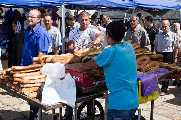 Kaek bread vendors display their merchandise outside the Damascus Gate hoping for business from Friday worshippers as they exit the Old City. Jerusalem, Israel. 21-September-2012.<br /> <br /> Thousands of Al-Aqsa worshippers disperse quietly after Friday prayers through the Damascus Gate. A small group of one hundred stage a symbolic, ten-minute, protest against 'Innocence of Muslims' movie insulting Muhammad and followers.