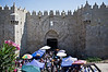 Thousands of Al-Aqsa worshippers disperse quietly after Friday prayers through the Damascus Gate. A small group of one hundred stage a symbolic, ten-minute, protest against 'Innocence of Muslims' movie insulting Muhammad and followers. Jerusalem, Israel. 21-September-2012.