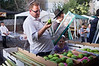 A father takes his daughter shopping for the Four Species at the Bait-Vagan Four Species Market. He inspects an etrog, the fruit of a citron tree and one of the 'Four Species', for imperfections. Jerusalem, Israel. 27-September-2012.<br /> <br /> With Yom Kippur over, preparations immediately begin for Sukkot, the Feast of Tabernacles. Religious Jews inspect and purchase the 'Four Species', as ordered in Leviticus 23:40. Any slight imperfection invalidates the fruit.
