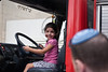 A young girl sits in the driver's seat of a fire truck at the Givat Mordechai Station as Jerusalem Fire Brigade opens its doors to the public. <br /> Jerusalem, Israel. 2-October-2012.<br /> <br /> Jerusalem Fire Brigade opens its doors to the public at Givat Mordechai Station enabling the public to see the work of firefighters from up close. The Jerusalem Fire Brigade annually responds to over 8,000.