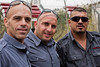 Left to right; Wisam Amer, Gul Gadalla and Muhamad Dwayat, three East-Jerusalem Arab volunteers, insist on their photo taken and personal backgrounds recorded, to promote voluntary Arab community service. Jerusalem, Israel. 2-October-2012.<br /> <br /> Jerusalem Fire Brigade opens its doors to the public at Givat Mordechai Station enabling the public to see the work of firefighters from up close. The Jerusalem Fire Brigade annually responds to over 8,000.