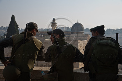 Three Border Policemen secure one of the entrances to the Western Wall overlooking Al-Aqsa Mosque as thousands of Jewish pilgrims attend the Blessing of the Priests on the holiday of Sukkoth. Jerusalem, Israel. 3-October-2012.  Thousands of Jewish pilgrims ascend to the Western Wall on the holiday of Sukkoth, one of three annual pilgrimages, for the Blessing of the Priests, Birkat Kohanim (Hebrew), occurring twice a year.