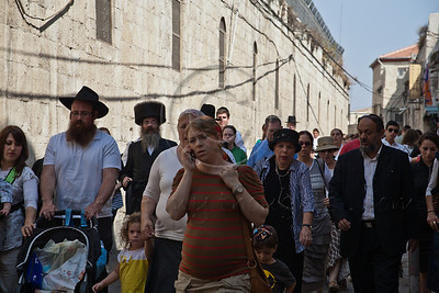 Thousands of Jews flock the Old City enroute to the Western Wall through the Armenian Patriarchate Road to attend a special Priestly Blessing service on the holiday of Sukkoth. Jerusalem, Israel. 3-October-2012.  Thousands of Jewish pilgrims ascend to the Western Wall on the holiday of Sukkoth, one of three annual pilgrimages, for the Blessing of the Priests, Birkat Kohanim (Hebrew), occurring twice a year.