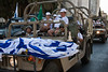 Holocaust survivors are hosted by the IDF on board military vehicles taking part in the annual Sukkoth Jerusalem Parade. Jerusalem, Israel. 4-October-2012.<br /> <br /> An estimated ten thousand people march in the annual Jerusalem Parade including participating delegations from around the world, Israeli industry, banks and military personnel. Jerusalem, Israel. 4-October-2012.