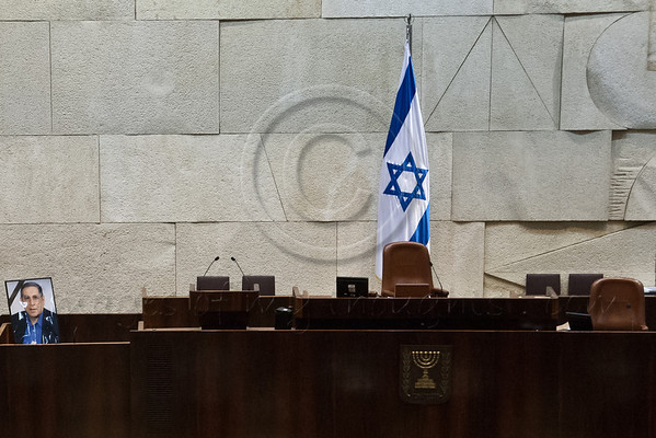 Knesset podium with photo of Rehavam 'Gandhi' Ze'evi (left) prior to the opening of a special session. Jerusalem, Israel. 16-October-2012.<br /> <br /> Knesset Plenum holds special session honoring the memory of Rehavam 'Gandhi' Ze'evi, former military general and MK, assassinated 17 October 2001 by Hamdi Quran of the Popular Front for the Liberation of Palestine.