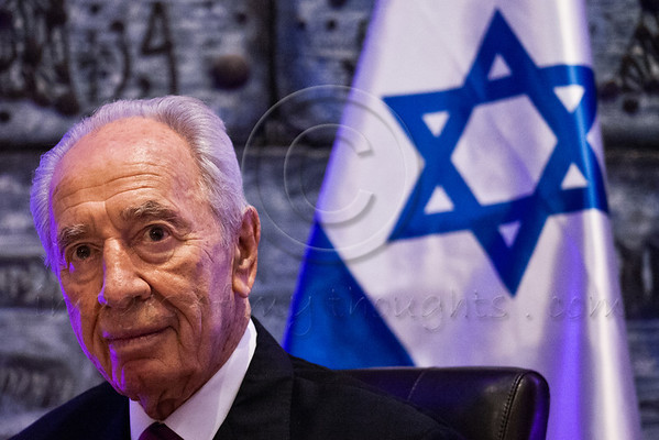 President Shimon Peres besides the flag of Israel. Jerusalem, Israel. 22 October 2012.<br /> <br /> President Shimon Peres hosts a state dinner in honor of Bulgarian President Rosen Plevneliev. The presidents deliver speeches to guests including senior political figures, diplomats and individuals from the economic, academic and cultural spheres.