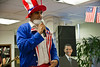 Sri Kulkarni, Director of the American Center in Jerusalem, leads democracy celebrations dressed as Uncle Sam on stilts. Jerusalem, Israel. 7-Nov-2012.<br /> <br /> Americans unite to celebrate democracy and monitor real-time election results at the US Embassy Tel-Aviv's American Center in Jerusalem as votes, still being counted, project a landslide victory for Pres. Barack Obama.