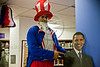 Sri Kulkarni, Director of the American Center in Jerusalem, poses with a cardboard cutout of President Barack Obama as he leads democracy celebrations dressed as Uncle Sam on stilts. Jerusalem, Israel. 7-Nov-2012.<br /> <br /> Americans unite to celebrate democracy and monitor real-time election results at the US Embassy Tel-Aviv's American Center in Jerusalem as votes, still being counted, project a landslide victory for Pres. Barack Obama.
