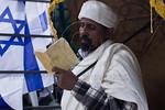A Jewish Ethiopian man in solemn prayer. Jerusalem, Israel. 14-Nov-2012.  The Jewish Ethiopian community in Israel, Beta-Israel, celebrates the Sigd Holiday, symbolizing their yearning for  ...