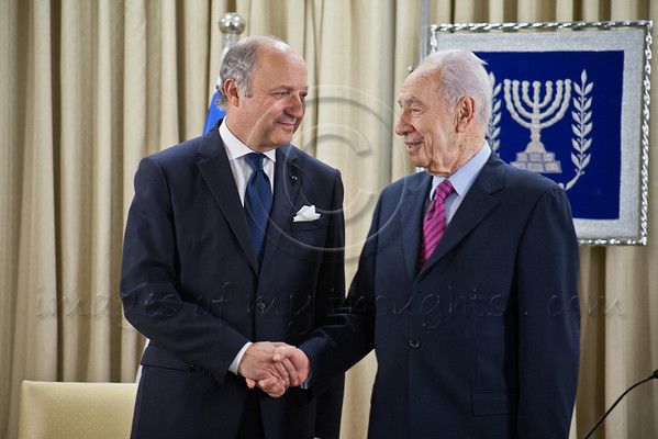Israeli President Shimon Peres and French Foreign Minister Laurent Fabius shake hands at the opening of a joint meeting. Jerusalem, Israel. 18-Nov-2012.<br /> <br /> Israeli President Shimon Peres meets French Foreign Minister Laurent Fabius who is visiting the region for meetings with the leaders of Israel and the Palestinian Authority in light of warfare in Gaza.