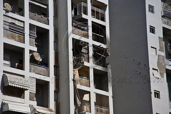 A Grad rocket launched from Palestinian controlled Gaza Saturday makes a direct hit into a residential apartment in Ashdod. Tenants, who followed Home Front Command instructions upon hearing the air-raid siren, were unhurt. Ashdod, Israel. 19-Nov-2012.