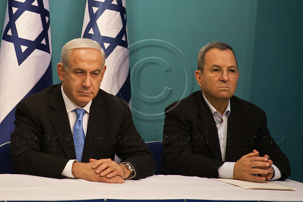 Prime Minister Benjamin Netanyahu (L) and Minister of Defense Ehud Barak (R) listen to address given by Minister of Foreign Affairs Avigdor Lieberman at a press conference announcing Pillar of Defense ceasefire agreement. Jerusalem, Israel. 21-Nov-2012.<br /> <br /> Prime Minister Benjamin Netanyahu holds a press conference with Foreign Minister Avigdor Lieberman and Defense Minister Ehud Barak announcing ceasefire agreement with Hamas ending Operation Pillar of Defense.