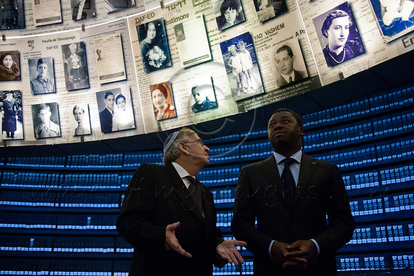 President of Togo, Faure Essozimna Gnassingbe, gazes up at enlarged Pages of Testimony displayed on the ceiling of the Hall of Names at Yad Vashem. Jerusalem, Israel. 27-Nov-2012.<br /> <br /> President of Togo, Faure Essozimna Gnassingbe, visits Yad Vashem Holocaust Museum. The President toured the museum, participated in a memorial ceremony and signed the museum guest book.
