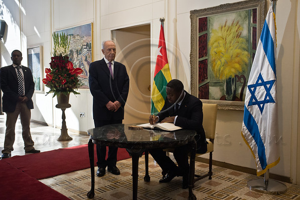 President of Togo, Mr. Faure Essozimna Gnassingbe, signs the guestbook at the President's Residence at the onset of a work meeting with President of Israel, Shimon Peres. Jerusalem, Israel. 28-Nov-2012.<br /> <br /> President of Israel, Shimon Peres, and President of Togo, Mr. Faure Essozimna Gnassingbe, hold a work meeting at the President's Residence. The two deliver statements and discuss strengthening the bilateral relations between the two countries.