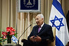 President of Israel, Shimon Peres, is depicted with the flag of Israel in the background at a work meeting with the President of Togo, Mr. Faure Essozimna Gnassingbe. Jerusalem, Israel. 28-Nov-2012.<br /> <br /> President of Israel, Shimon Peres, and President of Togo, Mr. Faure Essozimna Gnassingbe, hold a work meeting at the President's Residence. The two deliver statements and discuss strengthening the bilateral relations between the two countries.