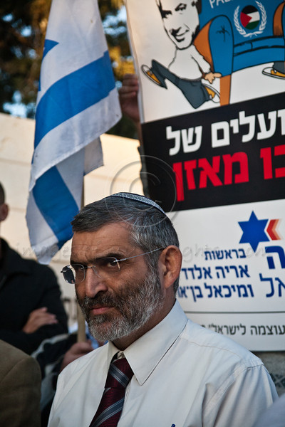 MK Michael Ben-Ari (R), of the Otzma Leyisrael Party, addresses protesters in front of United Nations Headquarters in Jerusalem, demonstrating against Palestinian statehood bid at the UN General Assembly in New York. Jerusalem, Israel. 29-Nov-2012.<br /> <br /> MKs Michael Ben-Ari and Aryeh Eldad, of the extreme right Otzma Leyisrael Party, lead activists in a Palestinian flag burning attempt at UN building in Jerusalem demonstrating against Palestinian statehood bid at the UN General Assembly in New York.