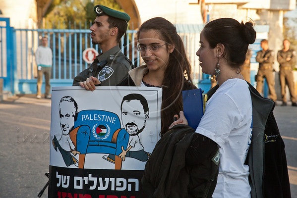 Two young women are among protesters at United Nations Headquarters in Jerusalem, demonstrating against Palestinian statehood bid at the UN General Assembly in New York. Jerusalem, Israel. 29-Nov-2012.<br /> <br /> MKs Michael Ben-Ari and Aryeh Eldad, of the extreme right Otzma Leyisrael Party, lead activists in a Palestinian flag burning attempt at UN building in Jerusalem demonstrating against Palestinian statehood bid at the UN General Assembly in New York.