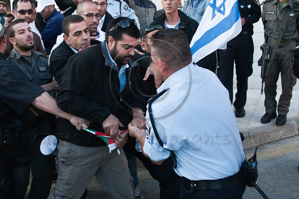 Uniformed police and plainclothes detectives use force to snatch a Palestinian flag from right-wing demonstrators to prevent it from being burned in protest. Jerusalem, Israel. 29-Nov-2012.<br /> <br /> MKs Michael Ben-Ari and Aryeh Eldad, of the extreme right Otzma Leyisrael Party, lead activists in a Palestinian flag burning attempt at UN building in Jerusalem demonstrating against Palestinian statehood bid at the UN General Assembly in New York.