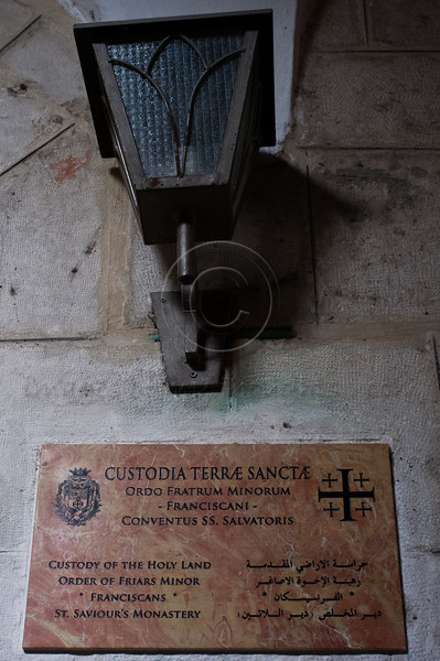 Lamp and sign at entrance to the Franciscan Terra Sancta compound and Saint Saviour's Monastery from Saint Francis Street in Jerusalem's Old City. Jerusalem, Israel. 30-Nov-2012.<br /> <br /> Of the 20,000 Franciscan monks worldwide about 300 reside in Israel as well as some 1,000 nuns. Saint Francis Francesco of Assisi first arrived in the Holy Land in 1219 and they have been custodians of the holy sites ever since.