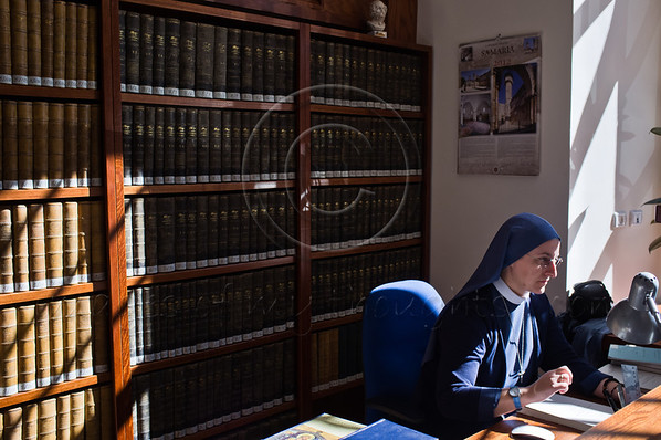 A nun is busy working in the Franciscan Terra Sancta compound library. Jerusalem, Israel. 30-Nov-2012.<br /> <br /> Of the 20,000 Franciscan monks worldwide about 300 reside in Israel as well as some 1,000 nuns. Saint Francis Francesco of Assisi first arrived in the Holy Land in 1219 and they have been custodians of the holy sites ever since.